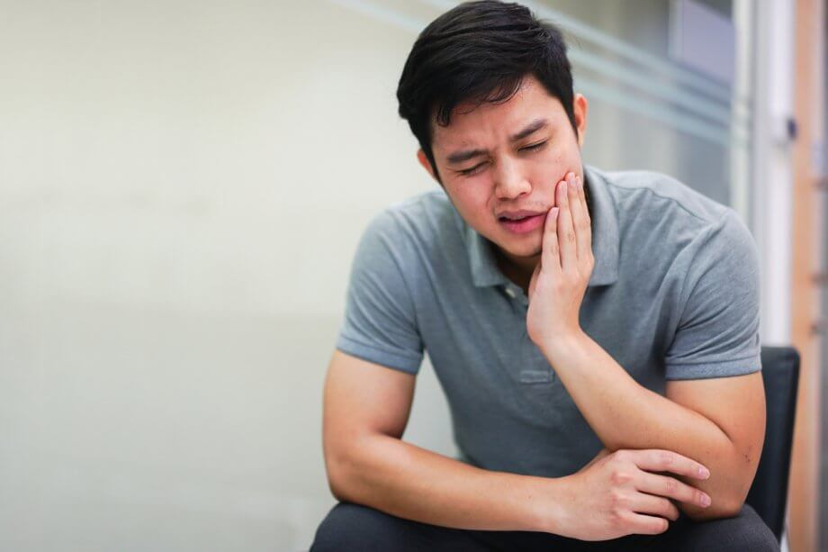 Close-up of Man Experiencing Jaw Pain